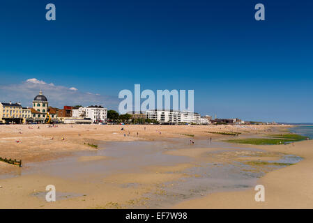 Worthing, as seen from the end of the pier, with low tide exposing a large expanse of beach - Stock Photo