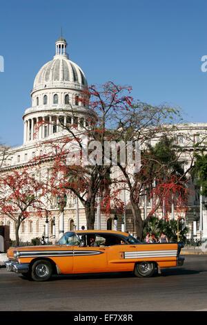 Retro car in front of the Capitol building in Havana, Cuba - Stock Photo