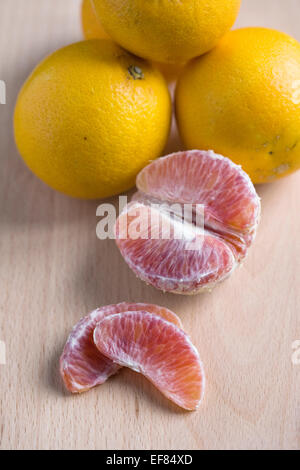 Citrus x sinenesis. Blood Oranges on a wooden board. - Stock Photo