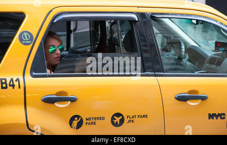 Woman in a taxi cab in New York City - Stock Photo