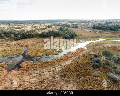 Africa, Botswana, Moremi Game Reserve, Aerial view of Khwai River flowing through Okavango Delta in Kalahari Desert - Stock Photo