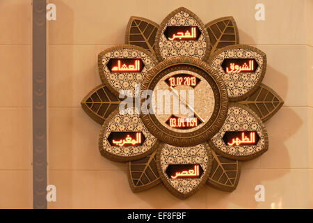 Islamic prayer clock in Sheikh Zayed bin Sultan al-Nahyan Mosque (Grand Mosque), Abu Dhabi, UAE - Stock Photo