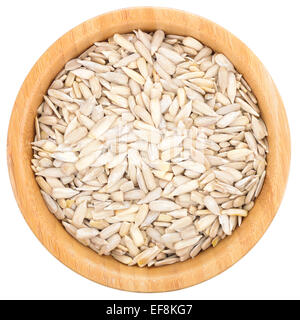Sunflower seeds in wooden bowl isolated oh white background. Top view. Healthy snack. - Stock Photo