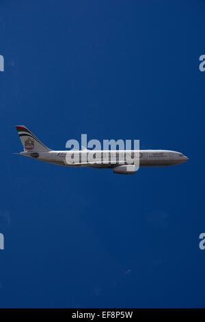 A6-EYK Etihad Airways Airbus A330-243 in flight against a blue sky - Stock Photo