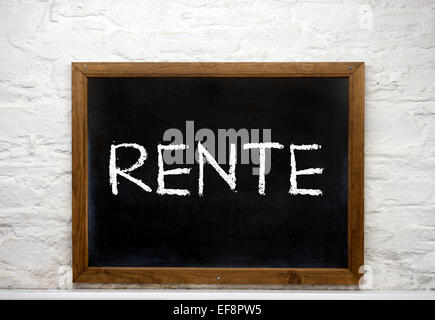Chalkboard with the word 'Rente', German for pension - Stock Photo