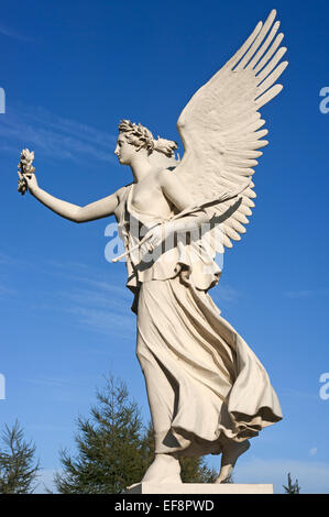 Floating Victoria sculpture, goddess of Victory, in the palace gardens of the Schweriner Schloss castle, Schwerin - Stock Photo