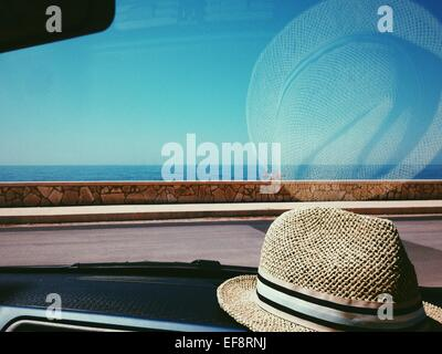 ... Straw hat on dashboard of car - Stock Photo a76ab52f4680
