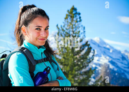 Italy, Active woman hiking outdoors and wearing backpack - Stock Photo