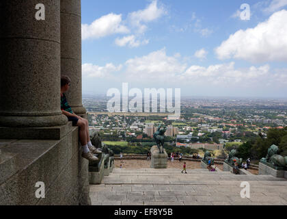 Tourists taking in the view from Rhodes Memorial on the lower slopes of Devil's Peak in Cape Town, South Africa. - Stock Photo