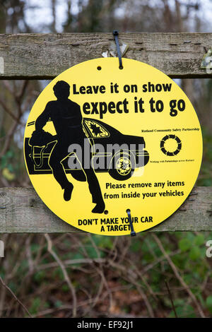 Round yellow sign warning against theft from cars. - Stock Photo