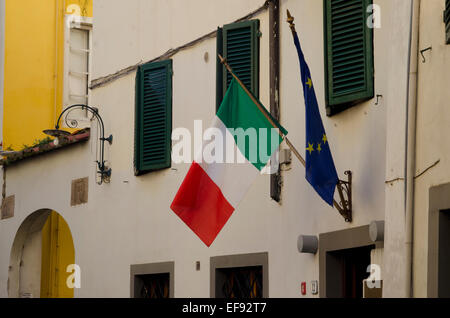 Italian and European Union flags on a building in Lucca, Tuscany, Italy - Stock Photo