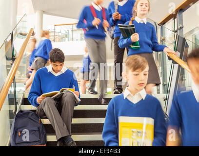 Students in corridor during break in high school - Stock Photo
