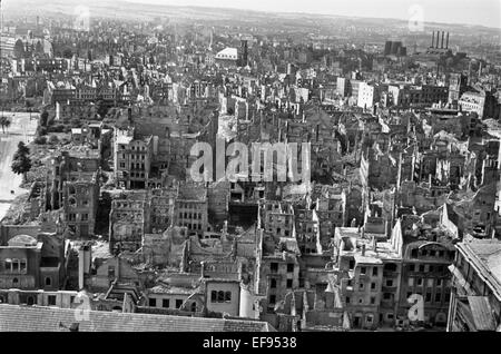 View from the Town Hall tower overlooking destroyed apartment buildings, the Annenkirche (St. Anne's Church) and - Stock Photo