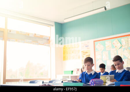 Elementary school children in classroom during lesson - Stock Photo