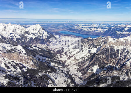 Swiss alpine Jungfrau region Lauterbrunnen valley and Thun lake landscape in  Bern Highland with city of Thun at - Stock Photo