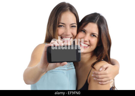 Two friends showing a blank smart phone screen isolated on a white background - Stock Photo