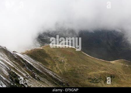 Cloud and snow The Maurerkogel and The Schmittenhohe above Zell am See Pinzgau Salzbergerland Austria - Stock Photo