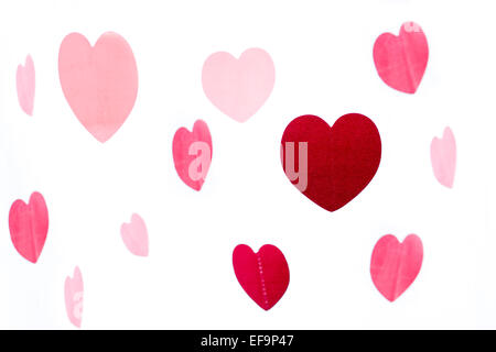 Group of colorful pink and red hearts isolated over white background - Stock Photo
