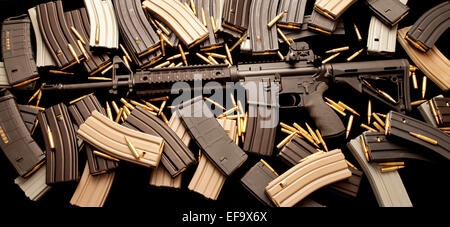 AR-15 assault rifle with high-capacity ammunition magazine clips and live ammo in caliber 5.56mm .223 - Stock Photo