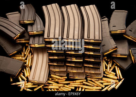 High capacity ammunition magazine clips filled with live 5.56mm .223 ammo - Stock Photo