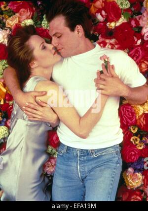 MARY STUART MASTERSON CHRISTIAN SLATER BED OF ROSES (1996) - Stock Photo