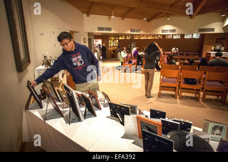 After an All Souls Day mass at St. Timothy's Catholic Church, Laguna Niguel, CA, an Asian American teenager looks - Stock Photo