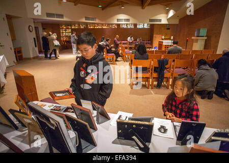 After an All Souls Day mass at St. Timothy's Catholic Church, Laguna Niguel, CA, an Asian American teenager and - Stock Photo