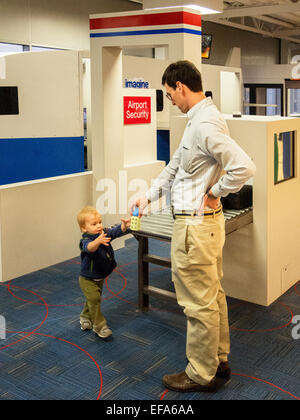A father and his toddler son play in the 1,500-square-foot  Lambert-St.Louis Airport 'Play Port' where children - Stock Photo