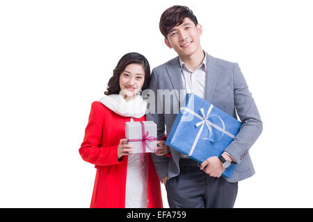 Happy young couple holding gifts - Stock Photo