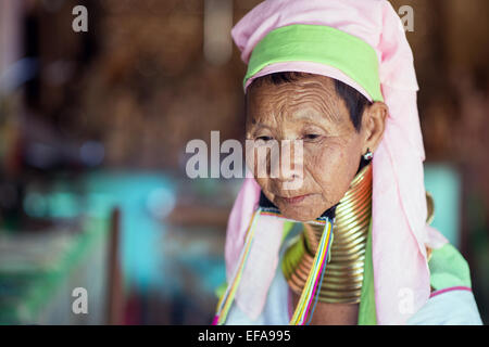 Portrait of a long neck Kayan woman. Brass coils creating long necks is a tradition of the Kayan Lahwi women.