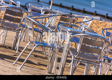 Close up of tables and chairs at cafe shop - Stock Photo