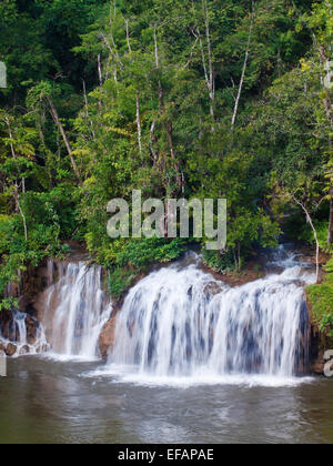 Sai Yok Yai waterfall flow into Khwae Noi river - Stock Photo