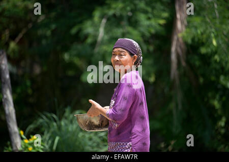 Woman portrait. Fishing gypsy village. Koh Mook (Muk) is a small rocky island off the coast of Trang province. On - Stock Photo