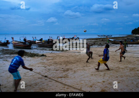 Playing football on the beach. Fishers village. Phi Phi don. Relax Beach. Phak Nam Bay. Thailand. Asia. Phi Phi - Stock Photo