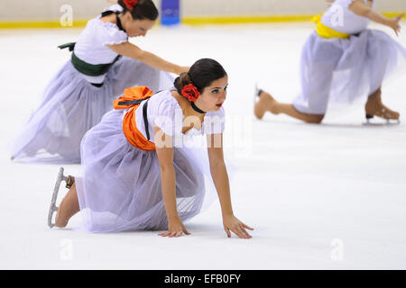 BARCELONA - MAY 03: Young team from a school of skating on ice performs, disguised as flamenco dancer. - Stock Photo