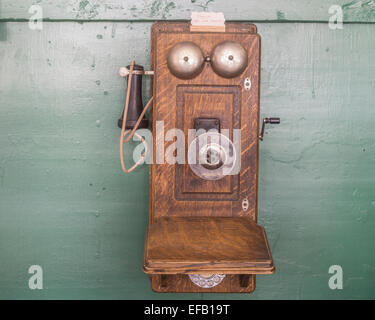 Old telephone with crank in the Museum City, South Pass City, Wyoming, United States - Stock Photo