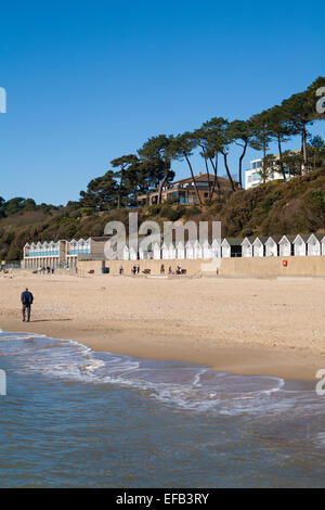 beach and beach huts at Branksome Dene Chine, Poole in March - Stock Photo
