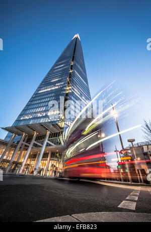 The Shard at dusk with bus moving past - Stock Photo