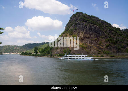 Passenger ship on the Rhine at the Lorelei rock, shale rock in the UNESCO World Heritage Upper Middle Rhine Valley - Stock Photo