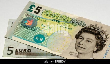 European Euro and United Kingdom Pound Bank Notes - Stock Photo