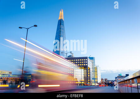 Light trails on London Bridge with the Shard in view - Stock Photo