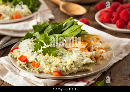 Healthy Spinach Egg White Omelette with Tomatos - Stock Photo