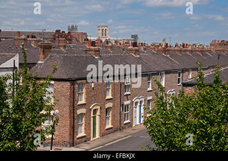 High view over rooftops of quaint Victorian red-brick terrace houses in residential conservation area, Minster beyond - Bishophill, York, England, UK.