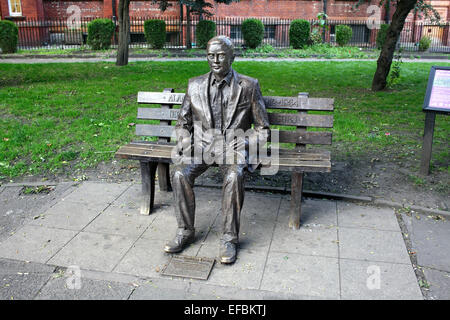 Statue of Alan Turing on a seat, in Sackville Gardens, Manchester. - Stock Photo