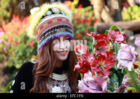 Traditionally dressed Mhong hill tribe woman in the garden at mountain - Stock Photo