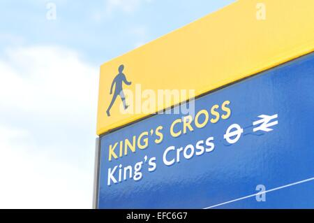 LONDON, UK. JULY 9, 2014: Detail of street sign showing directions to the King's Cross train station in London - Stock Photo
