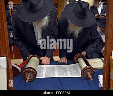 Torah reading during holiday morning prayers at a synagogue in Brooklyn, New York - Stock Photo