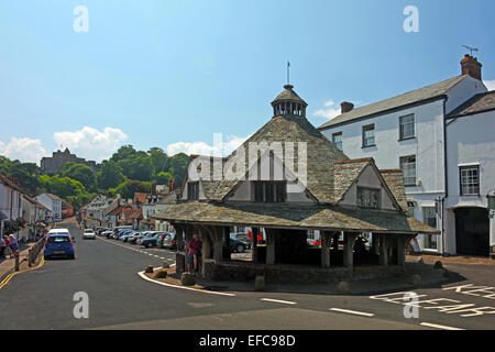 The historic Yarn Market in Dunster's main street with the castle beyond, Somerset, England, UK - Stock Photo
