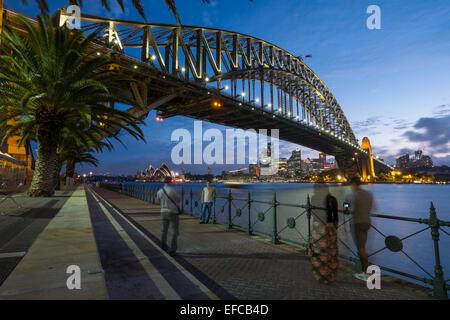 SYDNEY, AUSTRALIA- JANUARY 5, 2015: People taking pictures of the iconic Sydney Harbour Bridge with Sydney Opera - Stock Photo