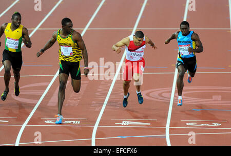 Jamaica's Kemar Bailey-Cole takes Commonwealth Games gold in the 100 metres final ahead of England's Adam Gemili - Stock Photo